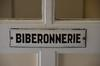 Rue de Molenbeek 38, Crèche Ernest Salu, plaque sur la porte de l'ancienne biberonnerie, 2015