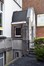 Rue Paul Janson 57, ancienne école des filles, bâtiment de 1927, porche d'entrée© ARCHistory / APEB, 2018
