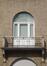 Place de Jamblinne de Meux 40, porte-fenêtre et balcon à garde-corps en fer forgé, 2011