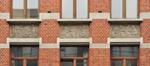 Rue Général Eenens 66, Institut Frans Fischer, bas-reliefs, 2013
