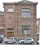Rue Pierre Decoster19-21-23, façade à rue du premier bâtiment scolaire avec première travée de 1906., 2019