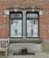 Ecuries, fenêtre à meneau en pierre à arc surbaissé devancées d'une grille en fer forgé, 2016